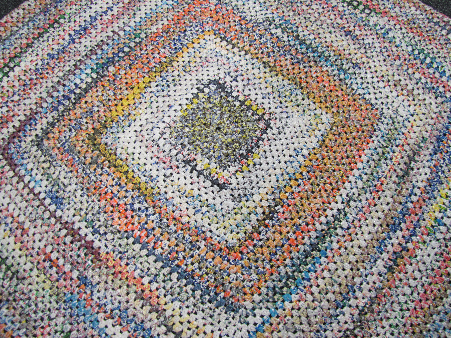 photographs of outdoor rug crocheted from plastic bags made by